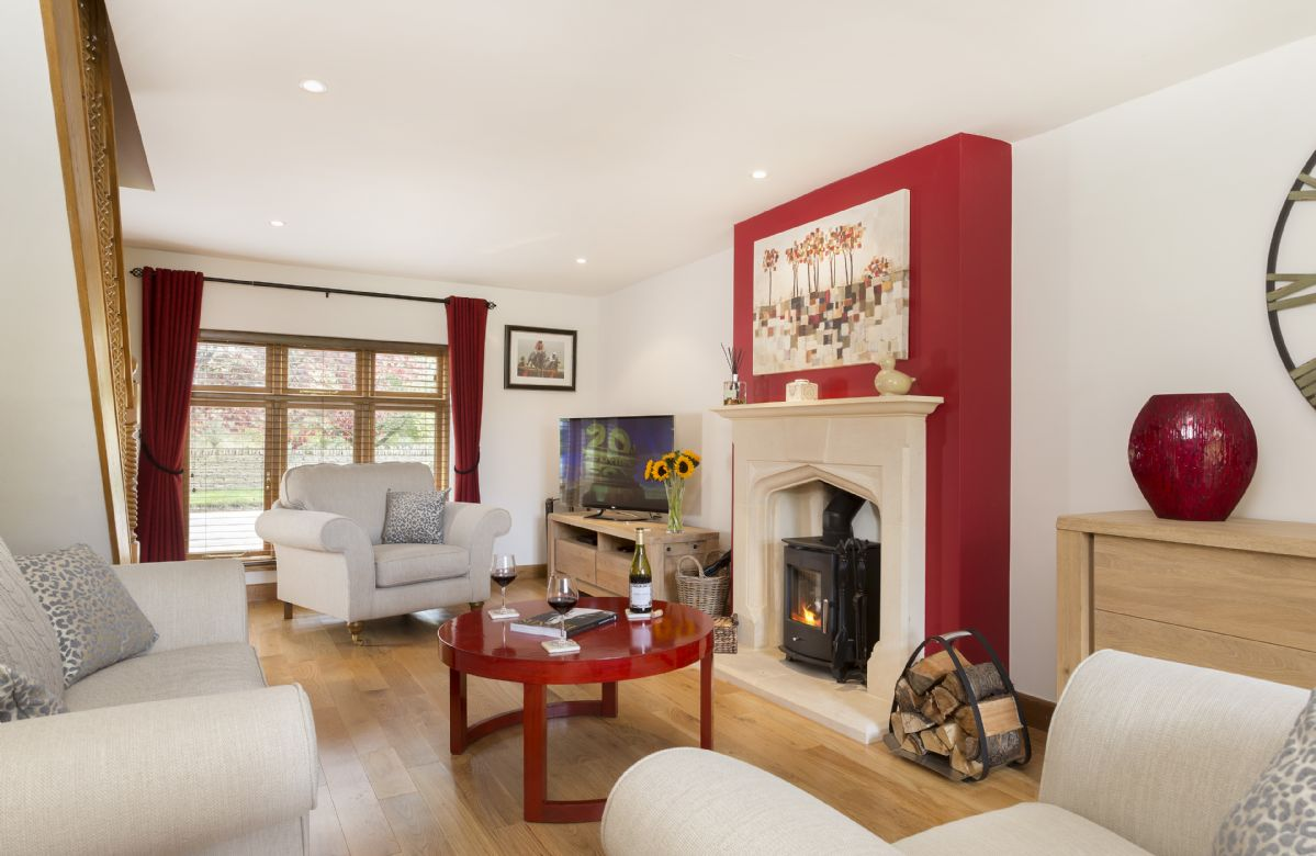 Ground Floor: Comfortable sitting  room with wood burning stove