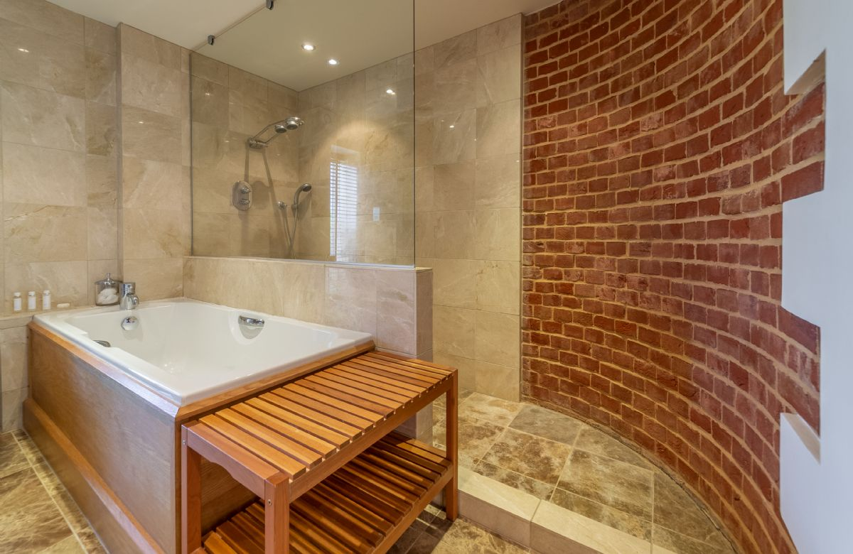 Ground Floor: Family bathroom with wet-room shower, WC & bath