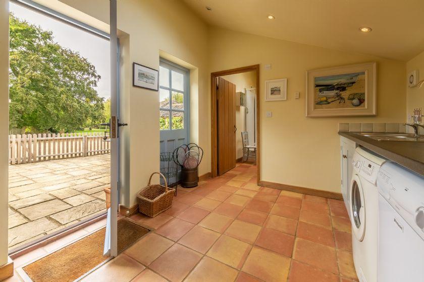 Ground floor: Utility room with door to courtyard and shower room