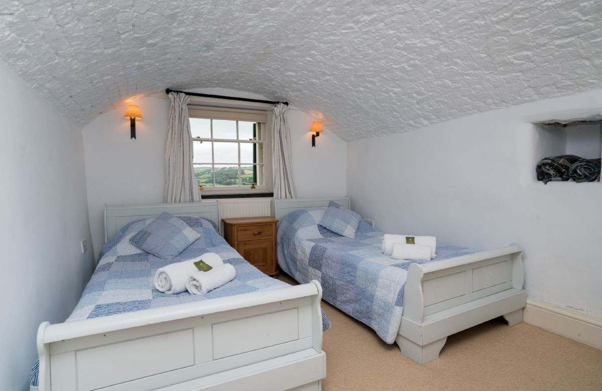 First Floor: Twin bedroom with 3' single zip and link beds which can be converted 6'King sized bed on request.