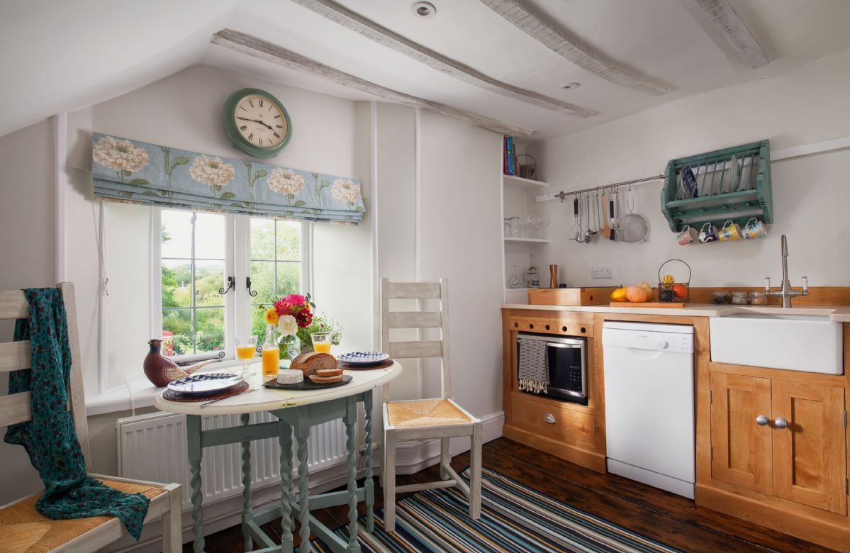 Mid floor: The quaint kitchen diner with original wooden flooring and handmade oak units