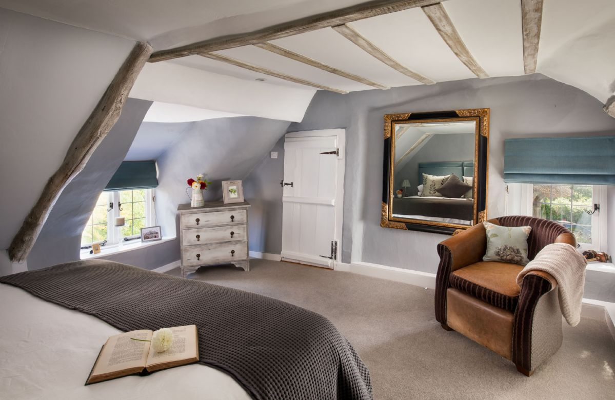 First floor: The master bedroom has space and light whilst keeping a wealth of its original character