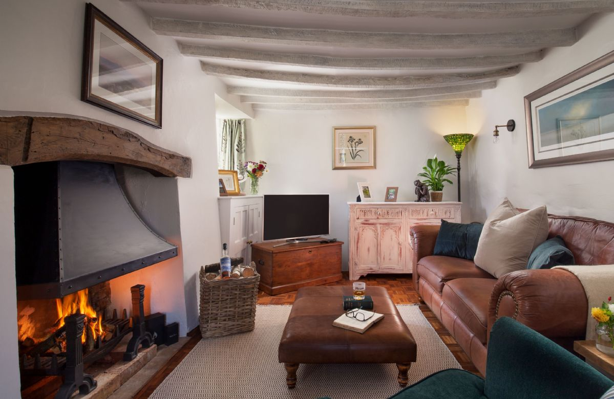 Ground floor: The large welcoming open fireplace and original wooden beams