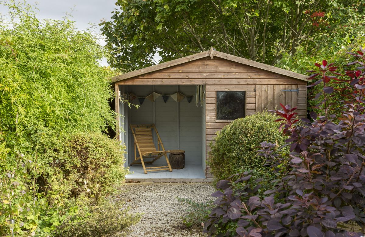 The garden is gated with many private areas and flowering shrubs such as jasmine and clematis