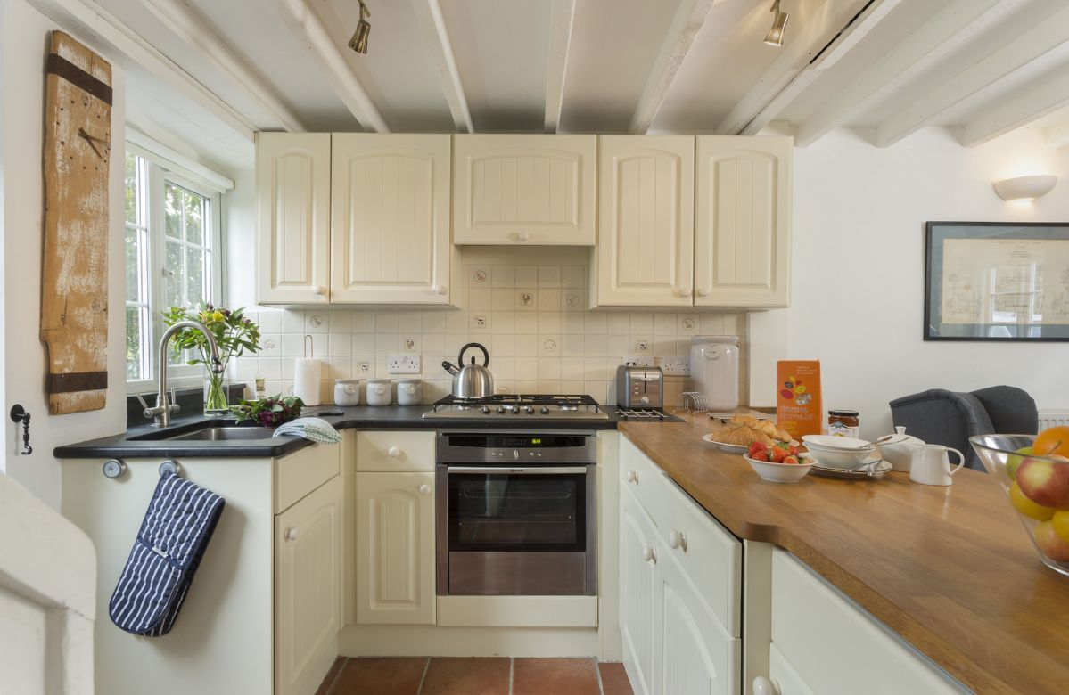Ground floor: The fully equipped kitchen with a stable door leading out into an enclosed garden