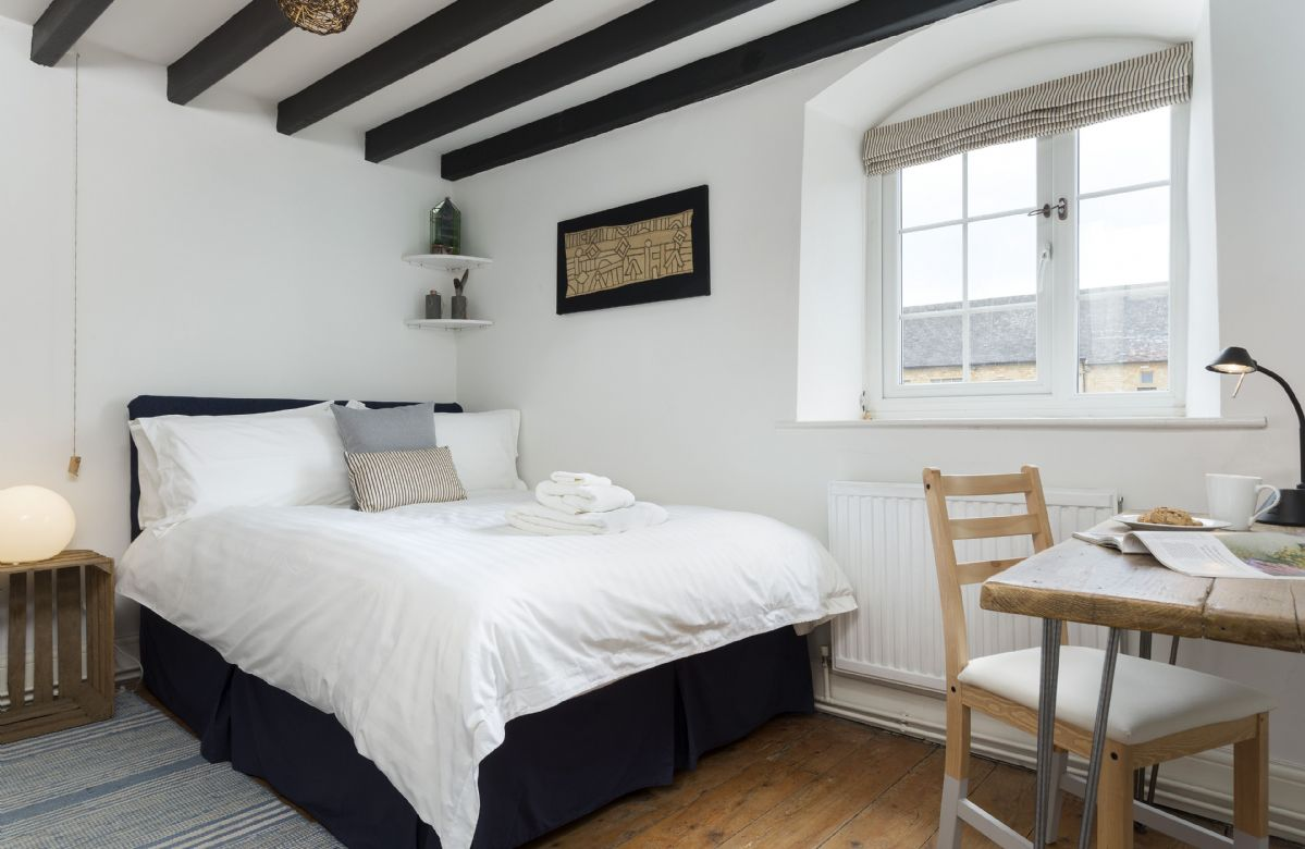 First floor: Bedroom with double bed and beamed ceiling