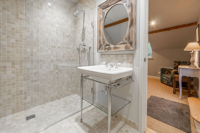 Annexe first floor: En-suite shower room with vanity basin