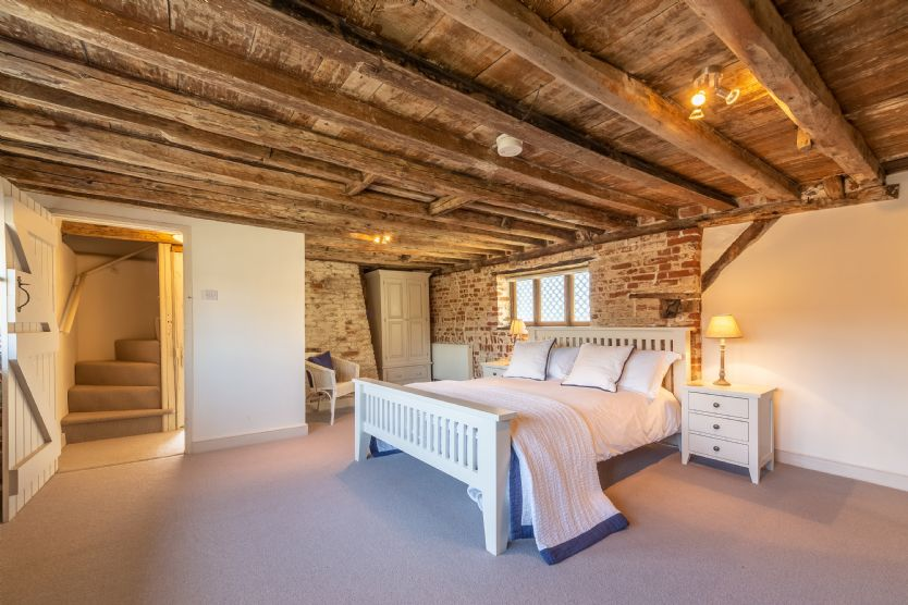 Second floor: Master bedroom which was formerly the old sail loft