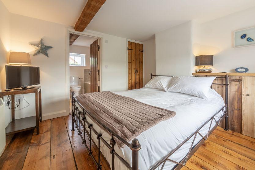 First floor: Master bedroom with door to family bathroom