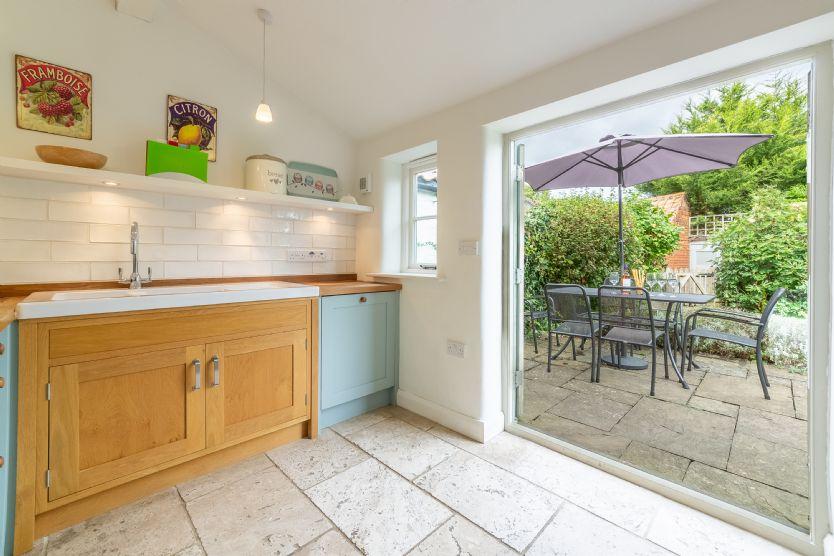Ground floor: Kitchen with doors to sunny rear garden