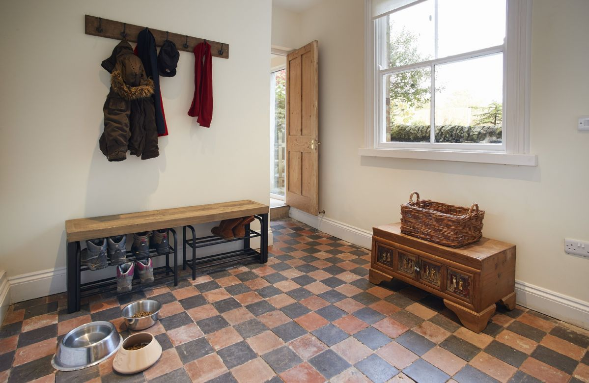 Ground floor: The boot and coat room with a door to the back garden