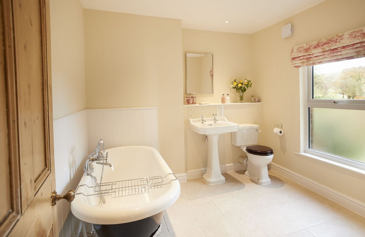 First floor: Bathroom with free standing roll top bath, handheld shower and underfloor heating
