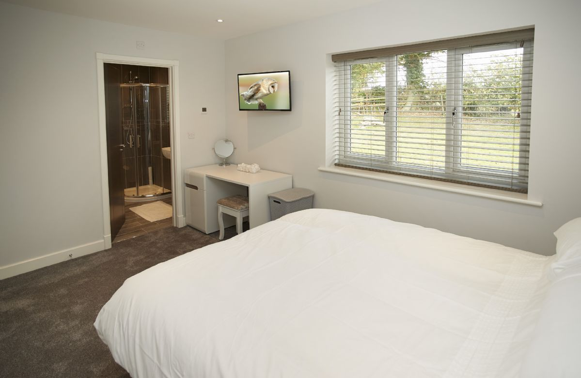 Ground floor: Double bedroom with king size bed and en-suite shower room