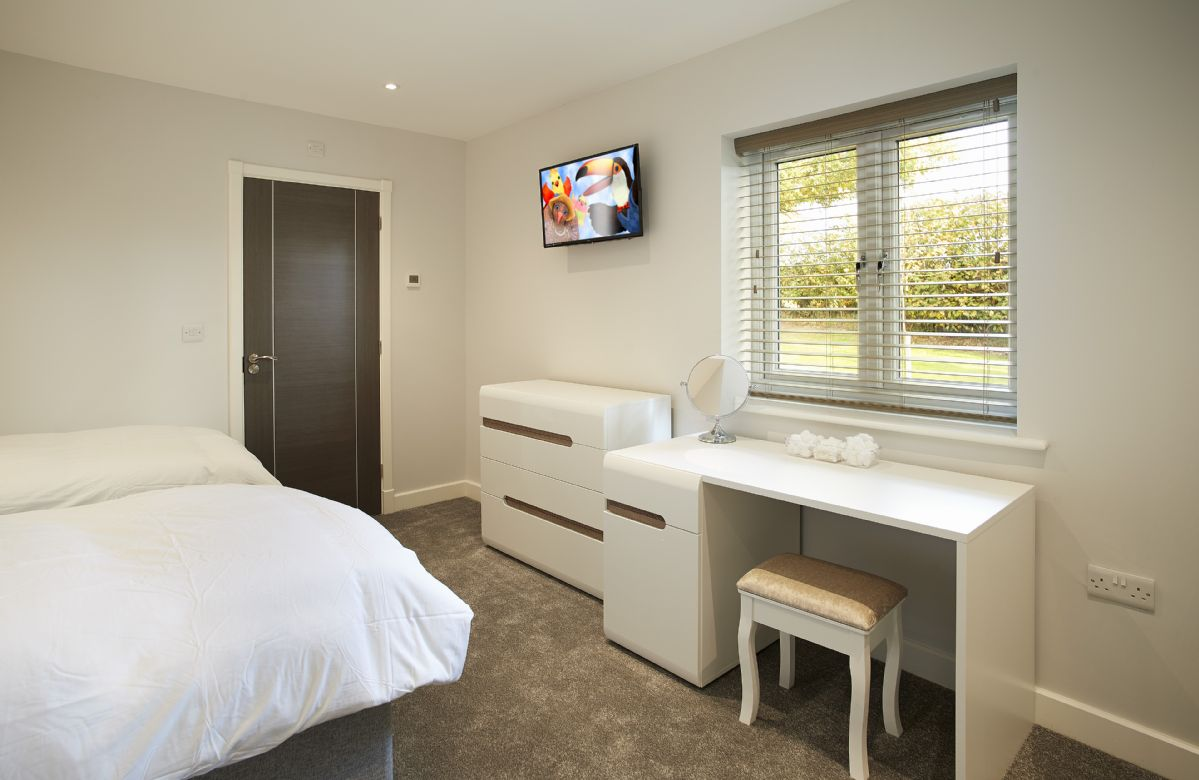 Ground floor: The twin bedroom with dressing table and en-suite shower room