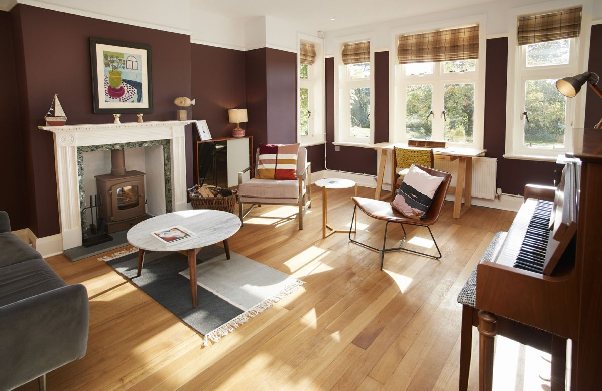 Ground floor: Sitting room with wood burner and beautiful piano