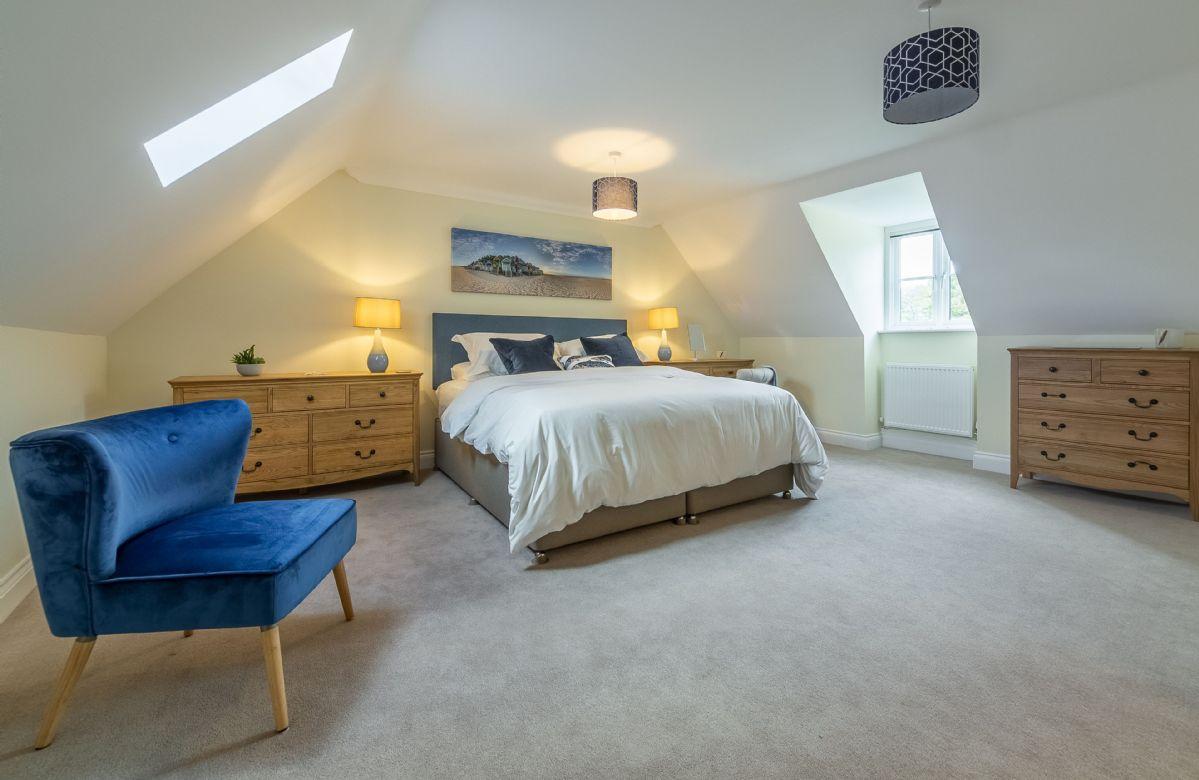 Second floor: Bedroom three with 6' super king bed and en-suite shower room.