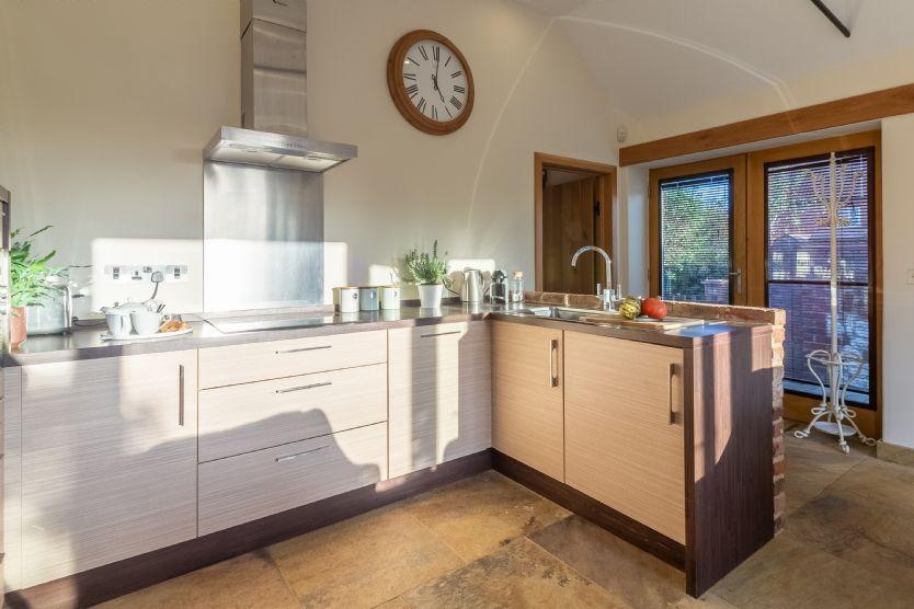 Ground floor: Kitchen area with French doors to garden