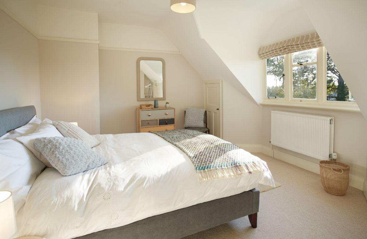 First floor: Double bedroom with 5' king size bed and country views
