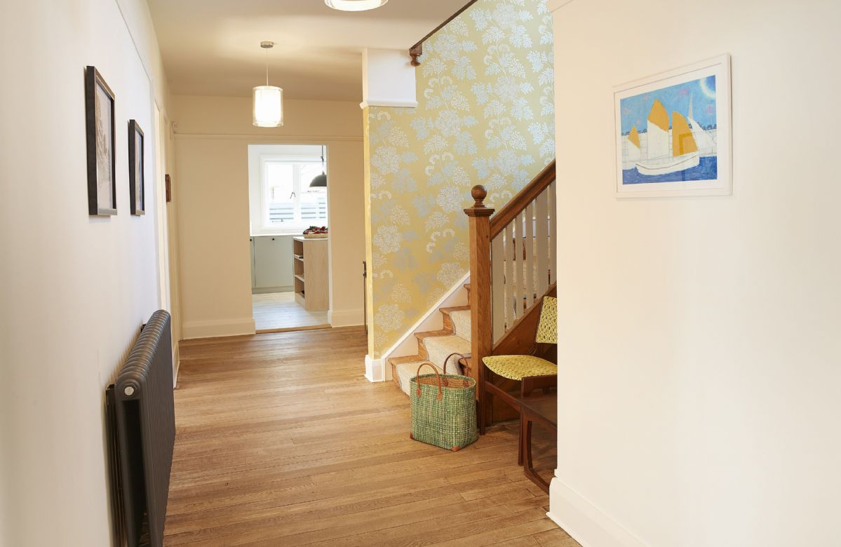 Ground floor: Large hallway with cloakroom