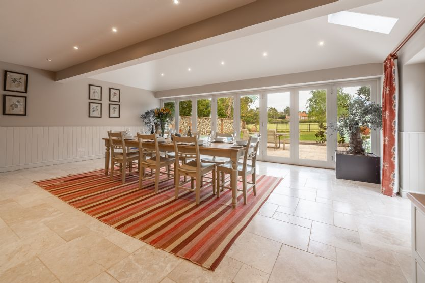 Ground floor: Dining area is light and bright with bi-fold doors to the garden