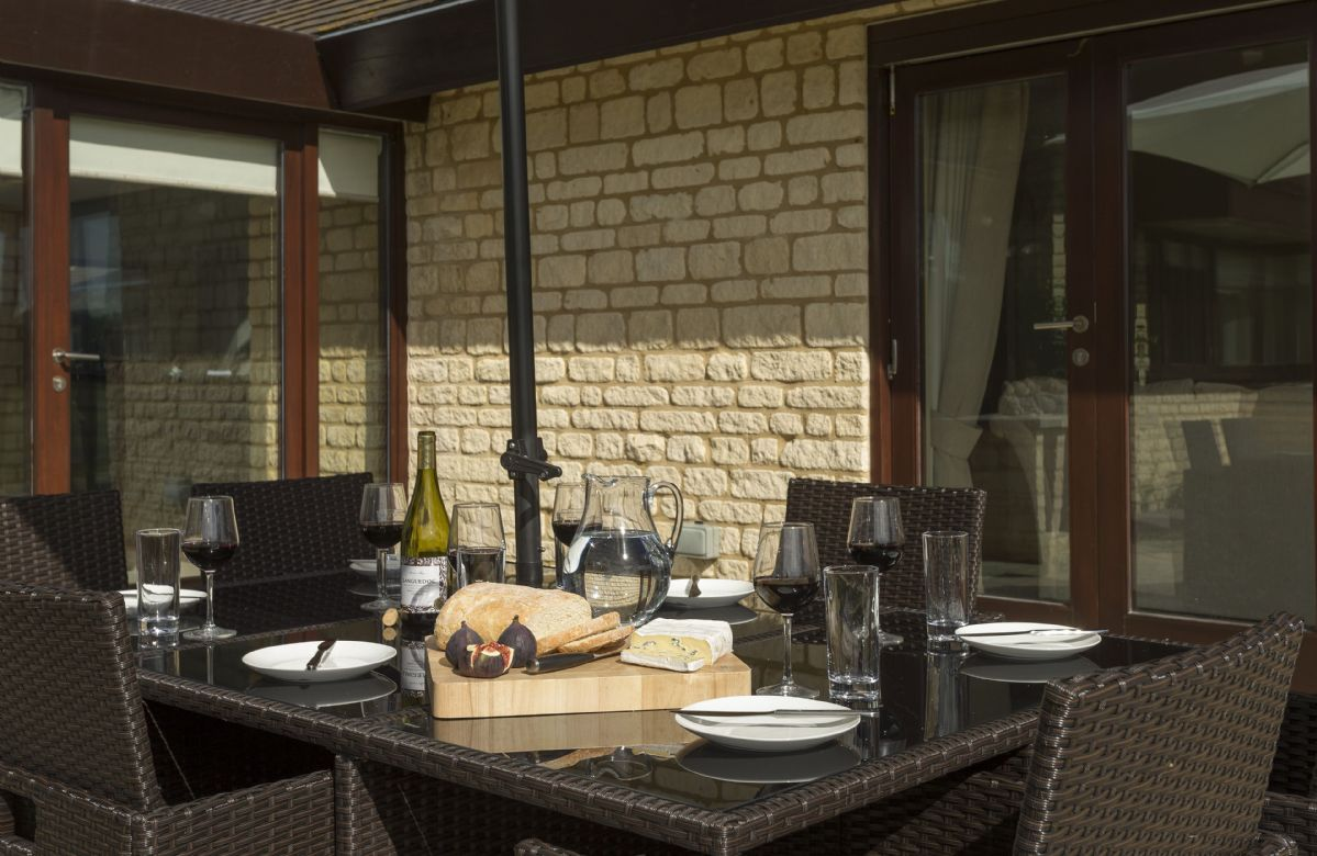 Enjoy dining outside al fresco in this wonderful private space