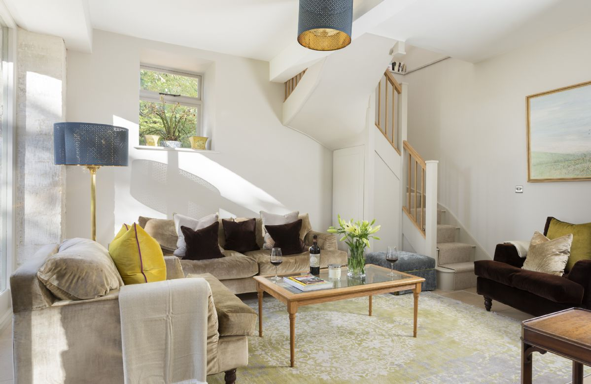 Ground floor: Sitting room with glazed opening to a former cart shed, with French doors to patio and garden