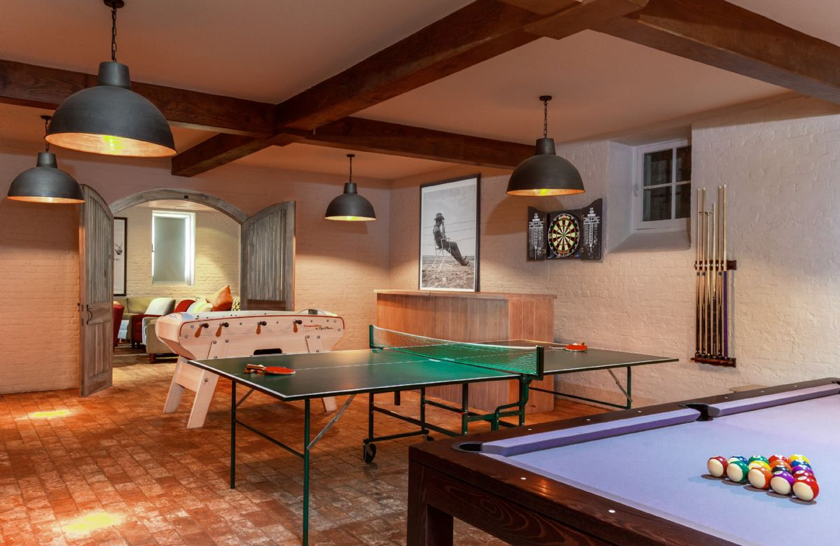 The games room with table tennis, table football and an X-Box
