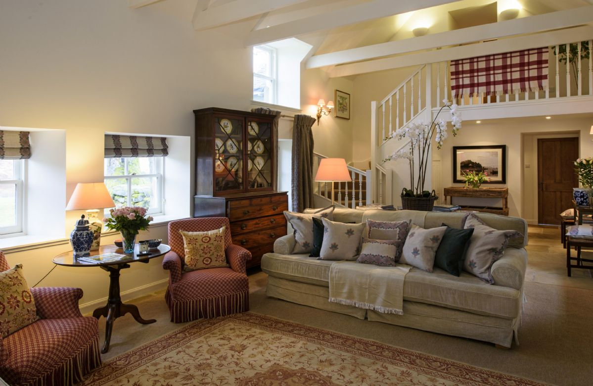 Ground floor: Large drawing room with double height ceiling and French windows leading to the garden