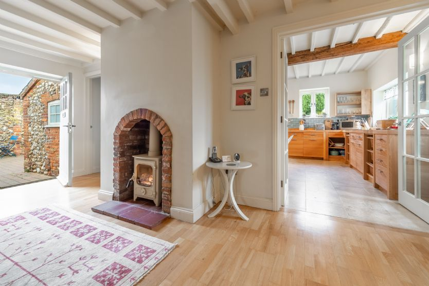Ground floor: The hallway even features a log burner, perfect for cooler evenings