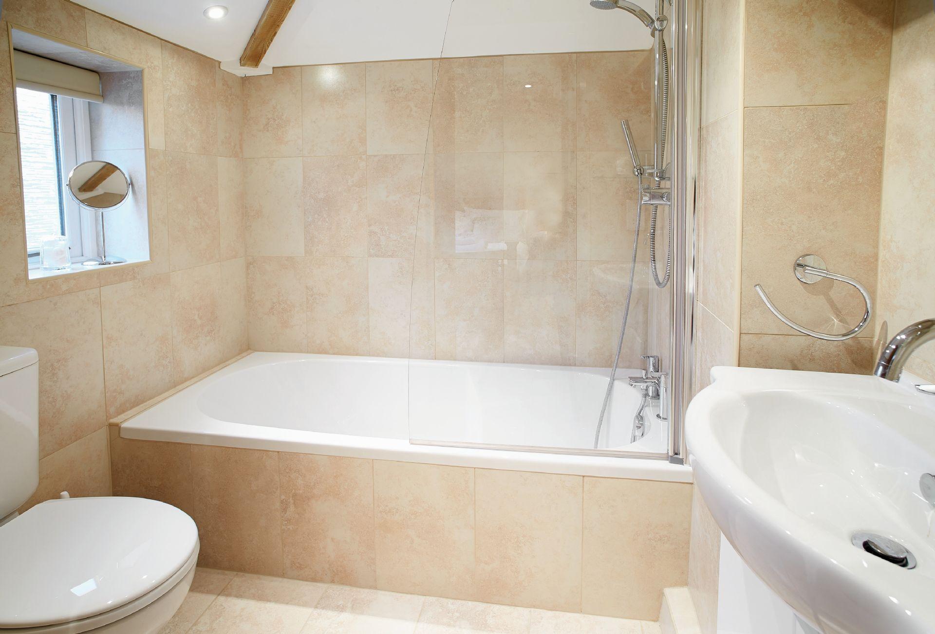 Ground floor:  En-suite bathroom with shower over