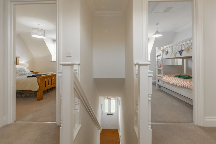 First floor: Landing, stairs, double bedroom and twin room