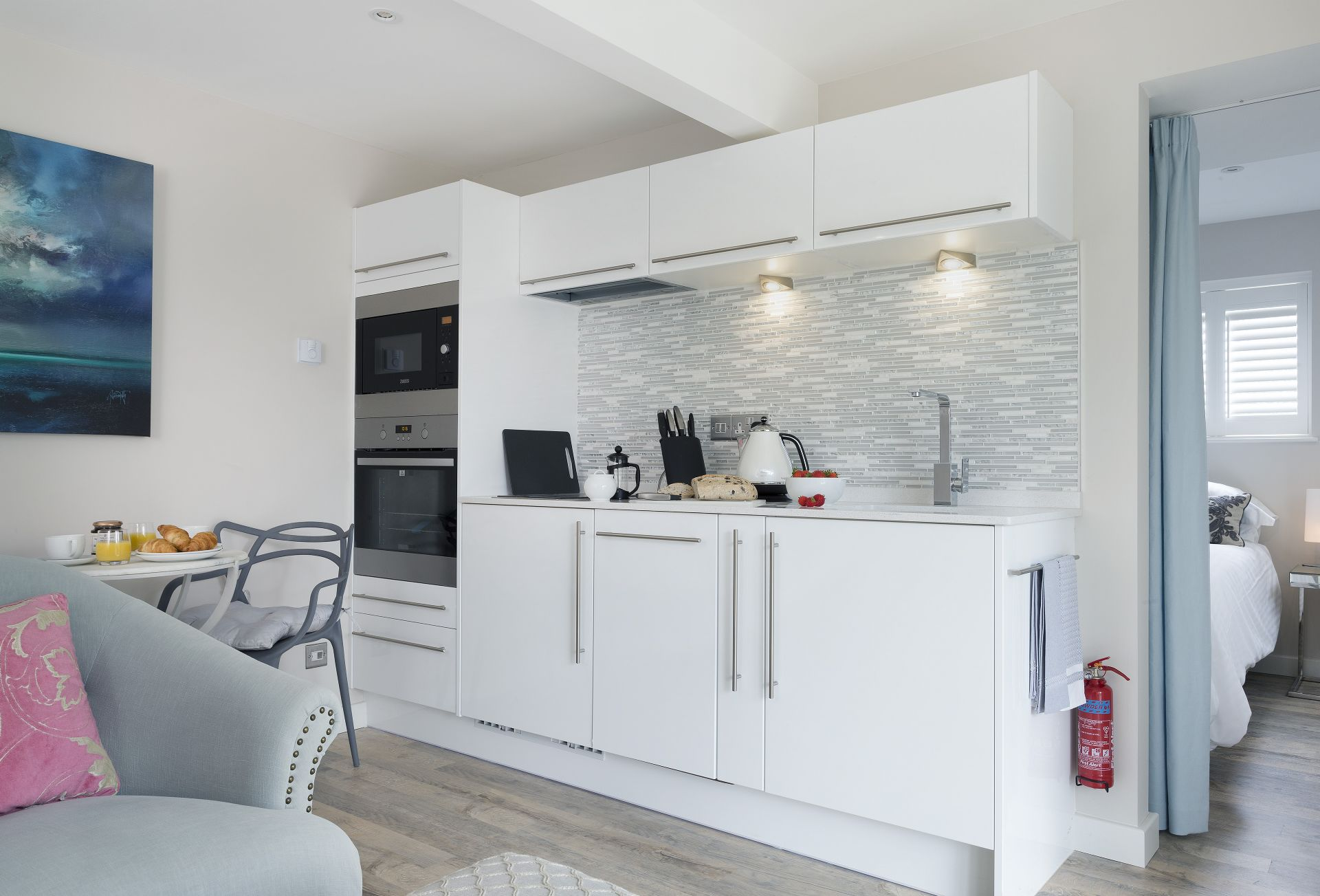 Ground floor: Open-plan living area with kitchen, dining table for two and sitting area