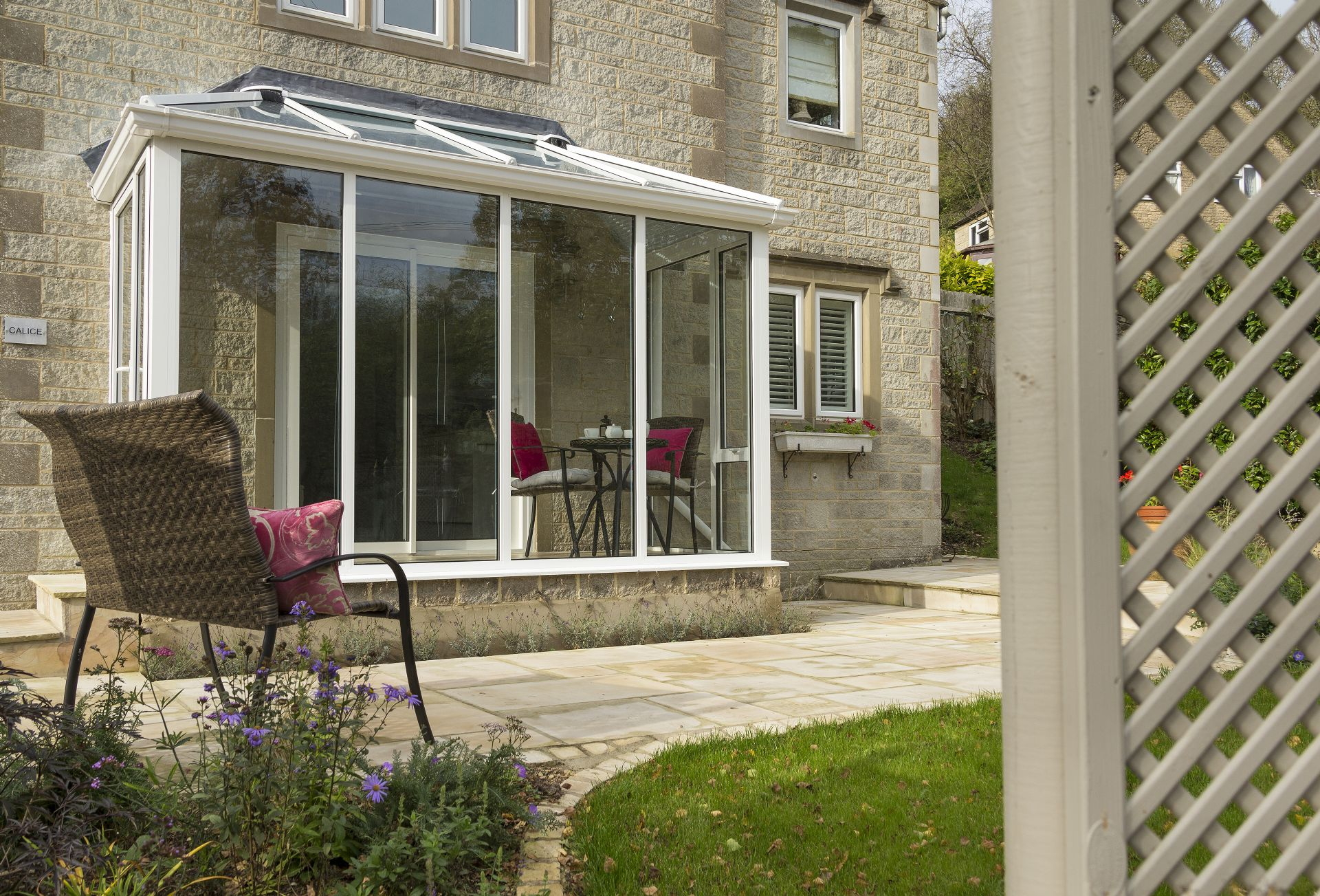 There is a second set of table and chairs in the small conservatory which looks onto the garden