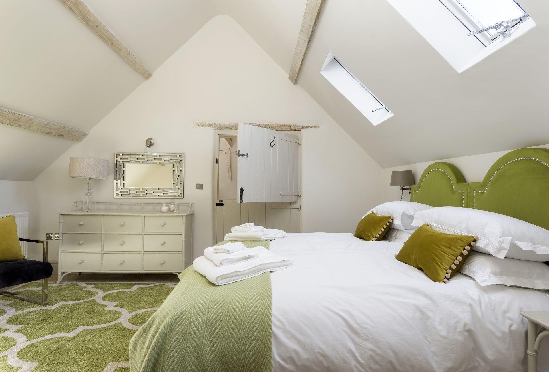 First floor: En-suite bedroom with twin beds