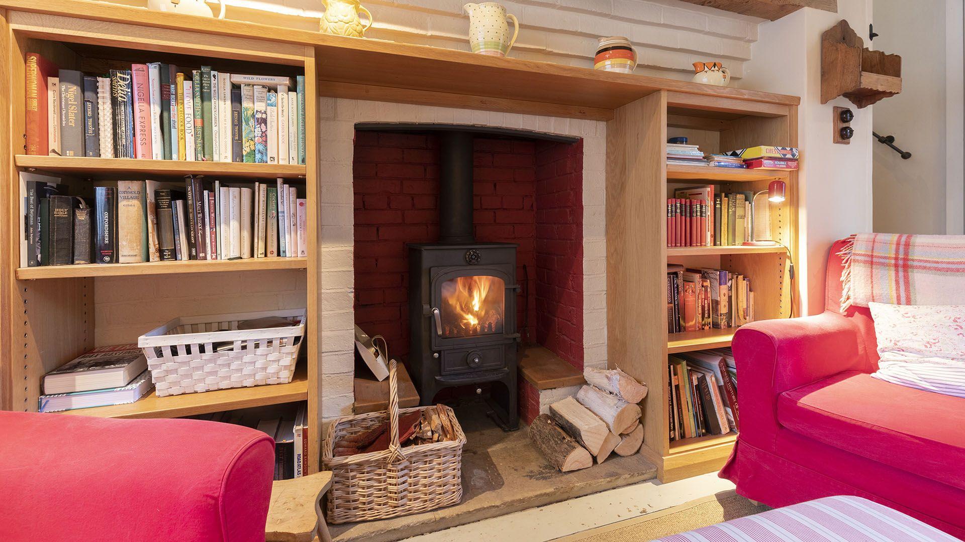 Sitting room with log burner, Church Cottage, Bolthole Retreats