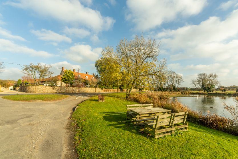 The cottage offers a pretty outlook over the village green and pond