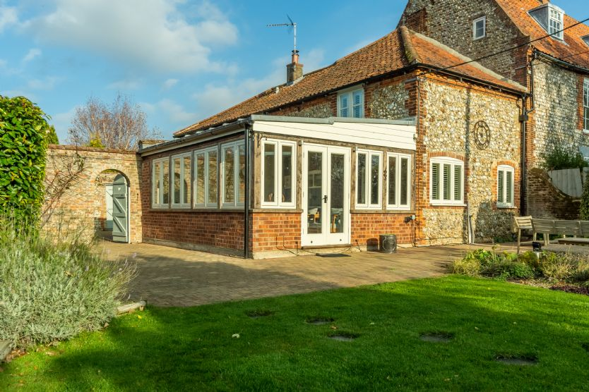 The conservatory/garden room offers fantastic views of the cottage walled garden