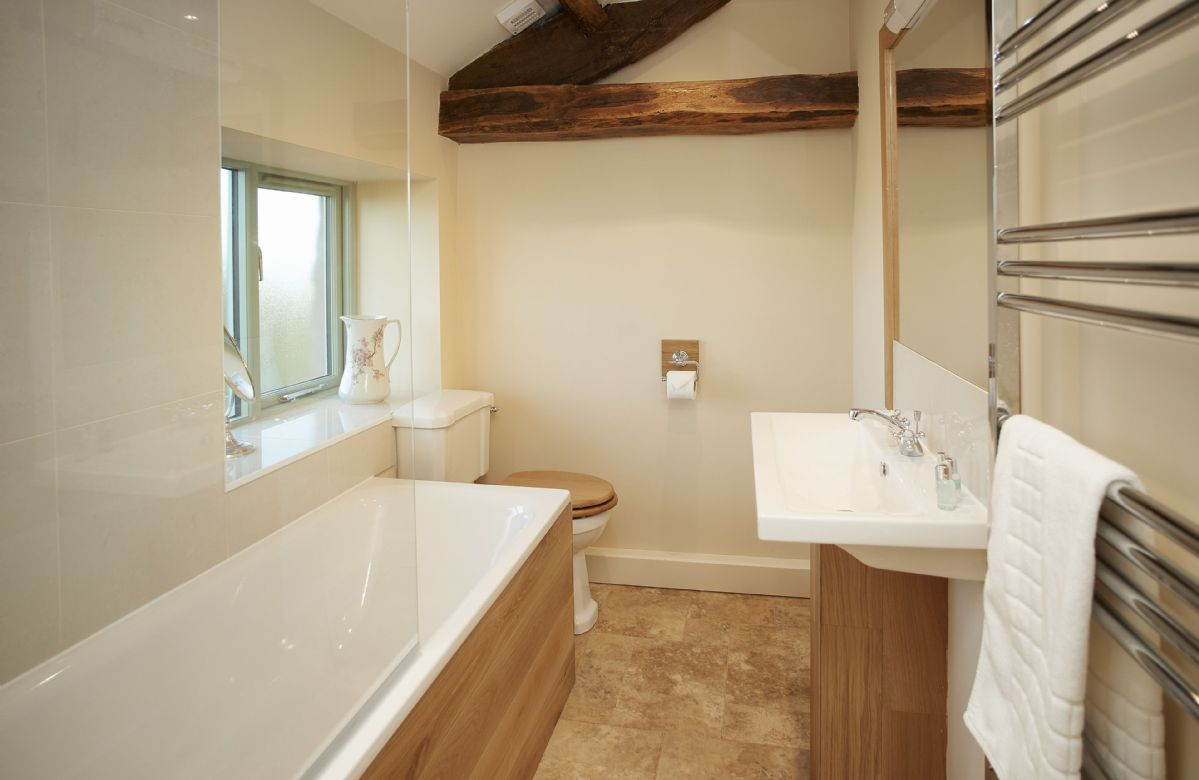 First floor: En-suite bathroom with handheld shower attachment belonging to Bedroom 3