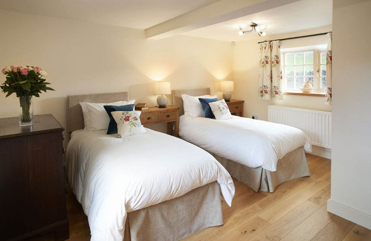 Ground floor: Bedroom 6 with 6' zip and link double bed and en-suite shower room