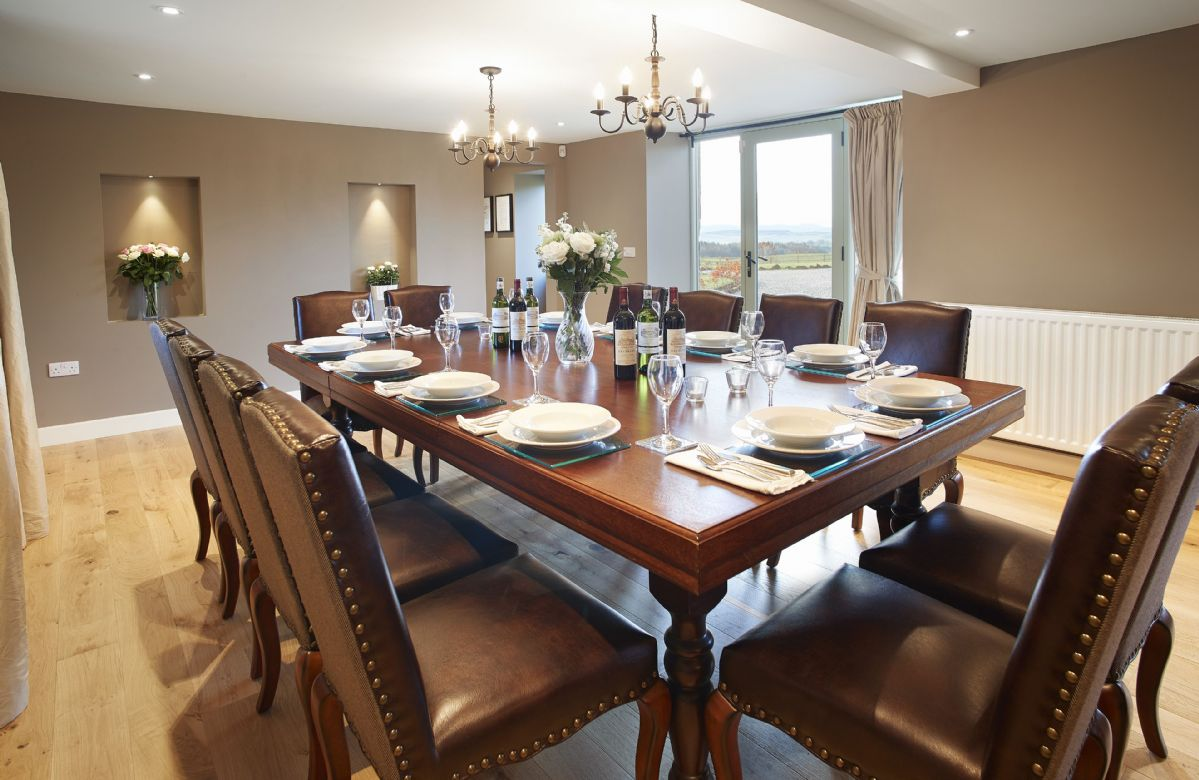 Ground floor: Dining room with table seating twelve guests