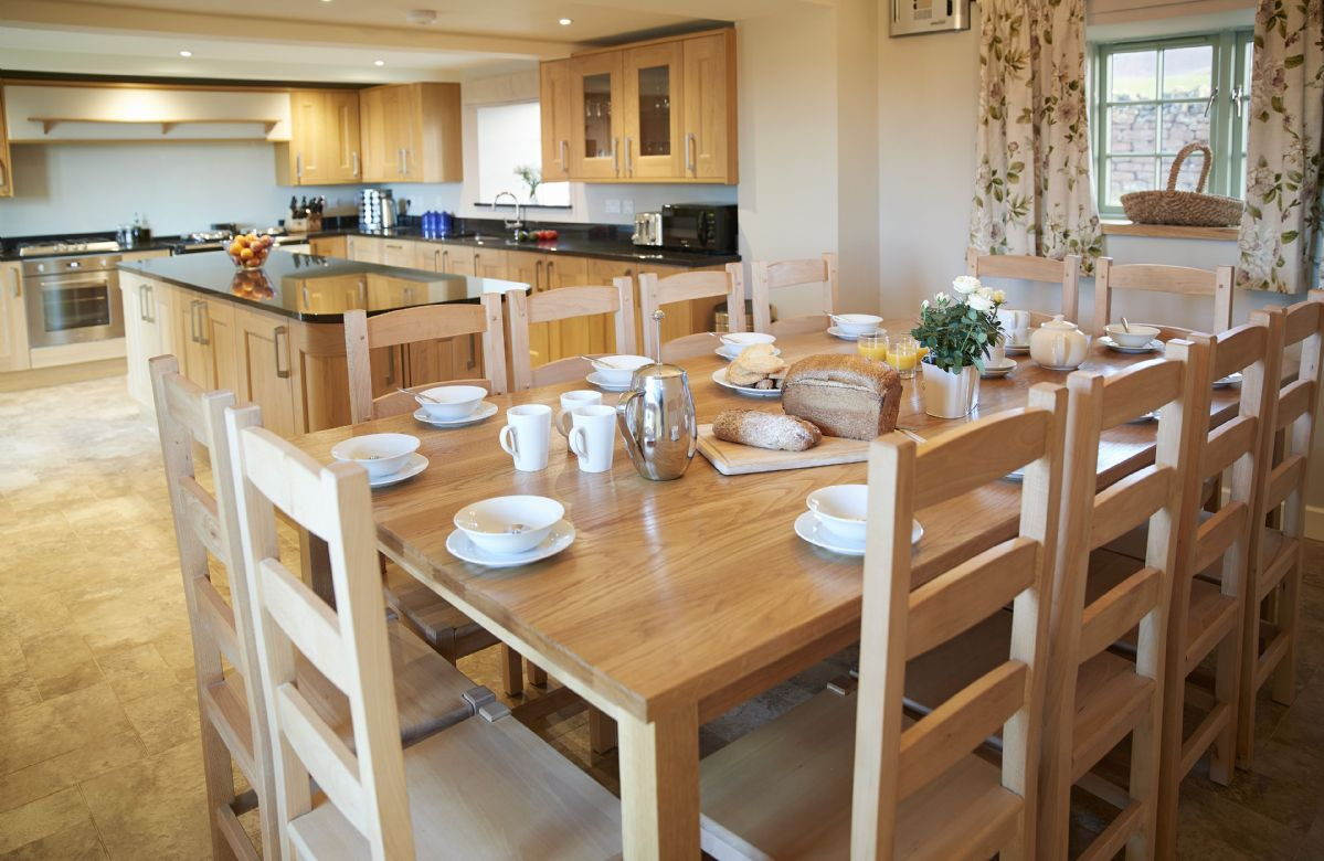 Ground floor: Kitchen with large breakfast table and granite topped island