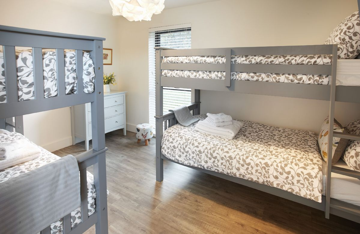 Ground floor: Large bedroom with four 3' bunk beds