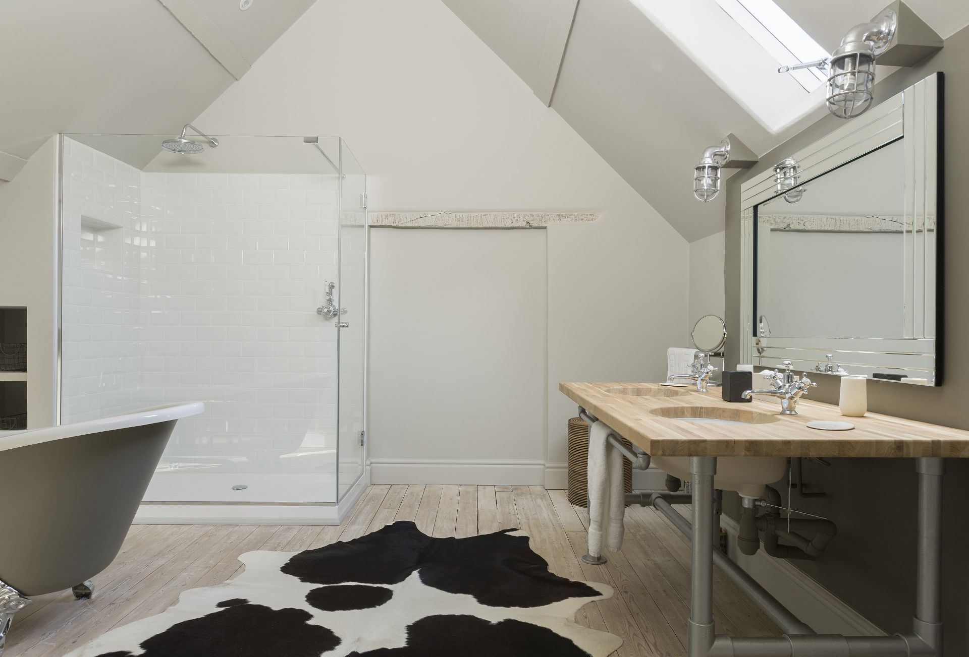 First floor: En-suite bathroom with roll-top bath and walk in shower