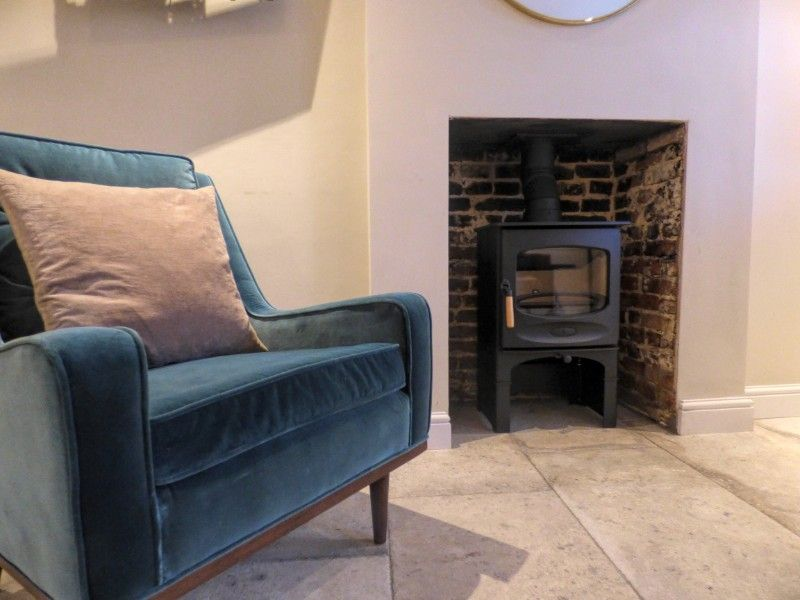 Shingle Cottage | Wood burner and comfy chair