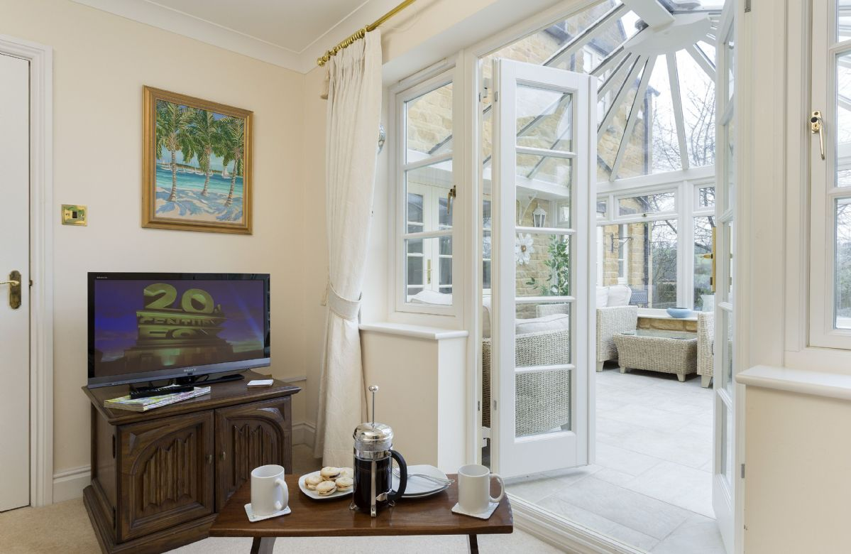 Ground floor: View leading from the garden room into the conservatory