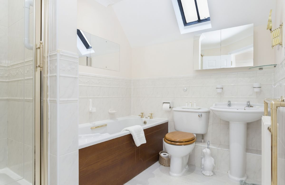 First floor: En suite bathroom with bath and separate shower