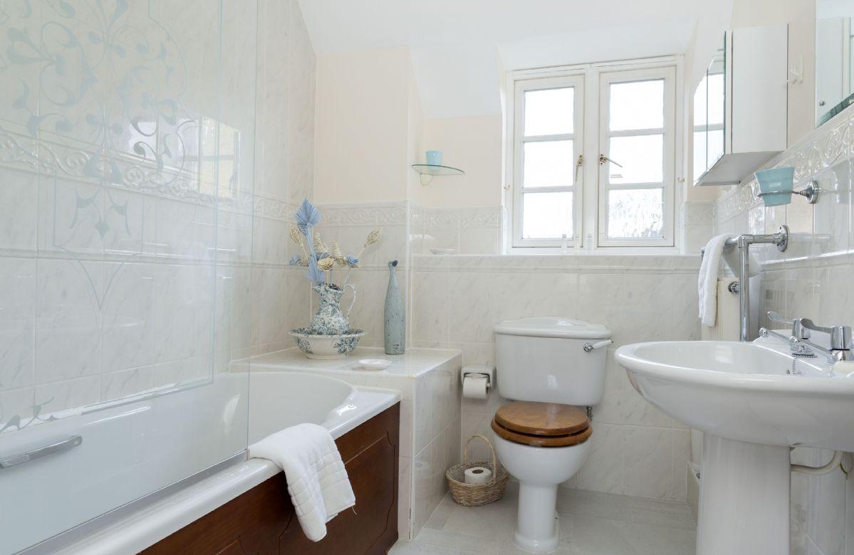 First floor: Family bathroom with bath with shower over bath