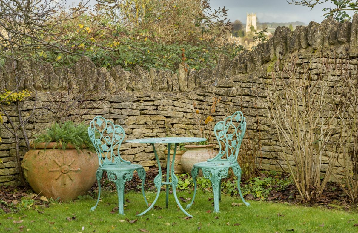 Quiet seating area in this traditional Cotswold garden