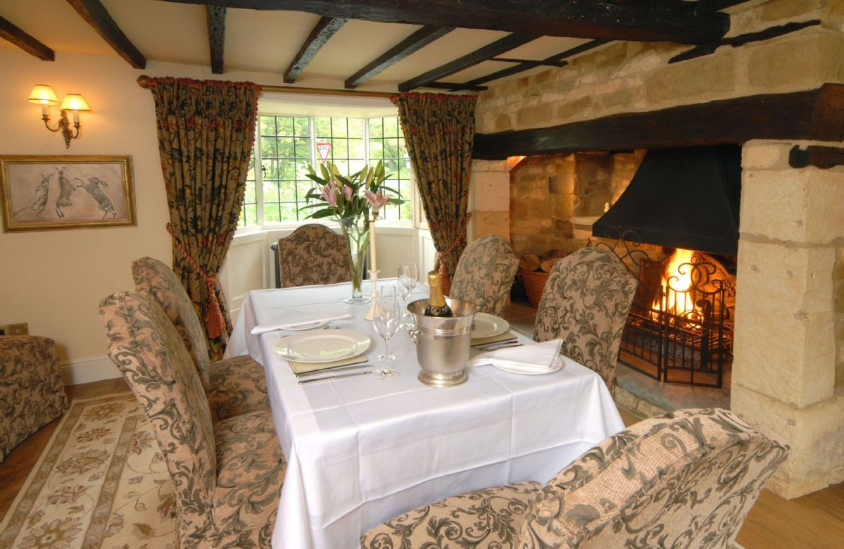 Ground floor:  Dining room with seating for eight in front of the large inglenook fireplace where an open fire roars in the cooler months creating the perfect ambiance for family feasts