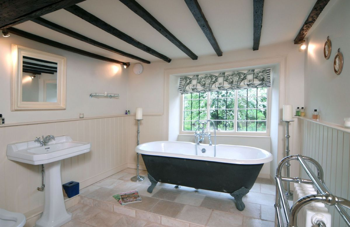 First floor: Bathroom with an impressive free standing roll top bath with a shower attachment